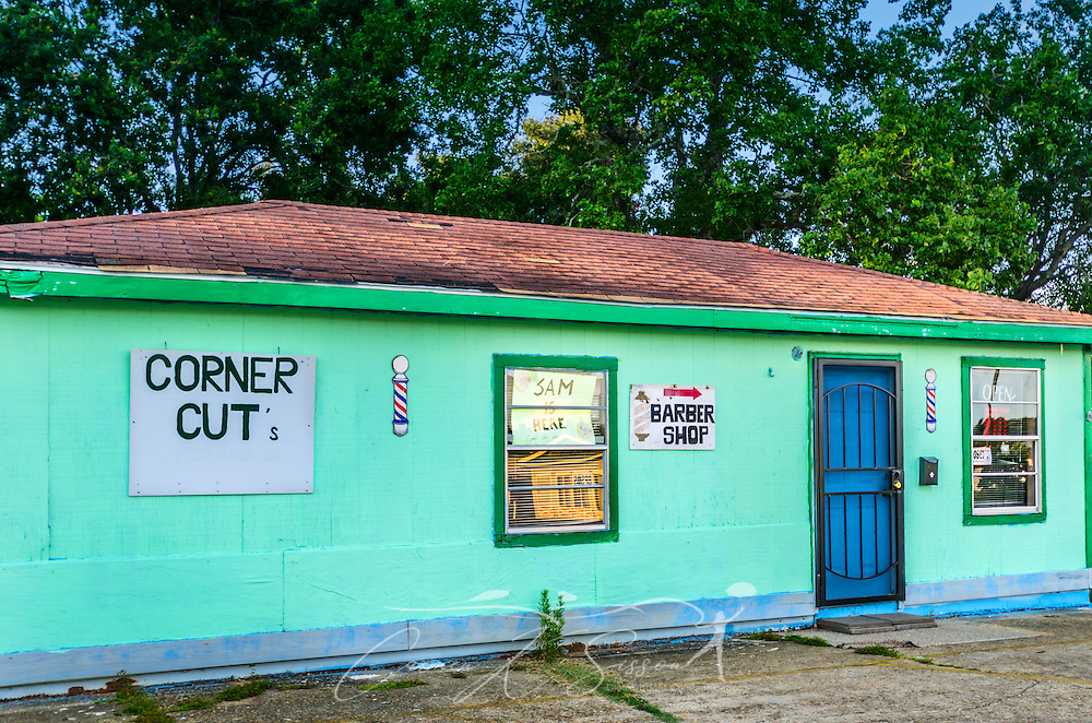 Corner Cuts barbershop is pictured, Aug. 15, 2015, in Bayou La Batre, Alabama. Owner Frank Morse, a former merchant mariner and fishing captain, opened the barbecue shack in 2006 after Hurricane Katrina put him out of work. (Photo by Carmen K. Sisson/Cloudybright)