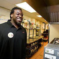 In this photo provided by Pizza Hut, Tampa Bay Buccaneers' offensive lineman Davin Joseph watches as a pizza he prepared for the lunch crowd heads in to the oven at Pizza Hut in Pinellas Park, Florida October 21, 2008. Joseph joined three other football players across the country in raising funds for the World Hunger Relief fund in the fight against world hunger. (AP Photo/Scott Audette, Pizza Hut)