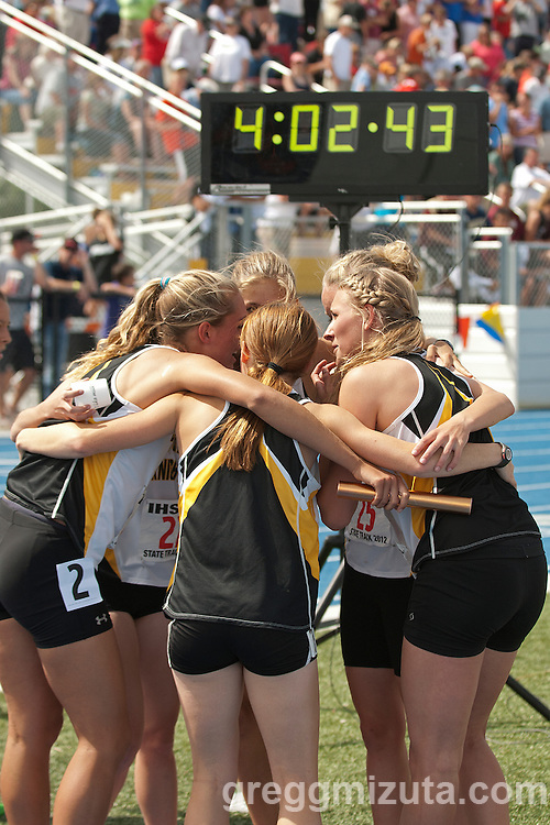 Bishop Kelly's state champion 4x400 meter relay team celebrates during the 4A Idaho Track and Field Championships on May 19, 2012 at Middleton High School, Middleton, Idaho. Bishop Kelly posted a winning time of 4:02.45.