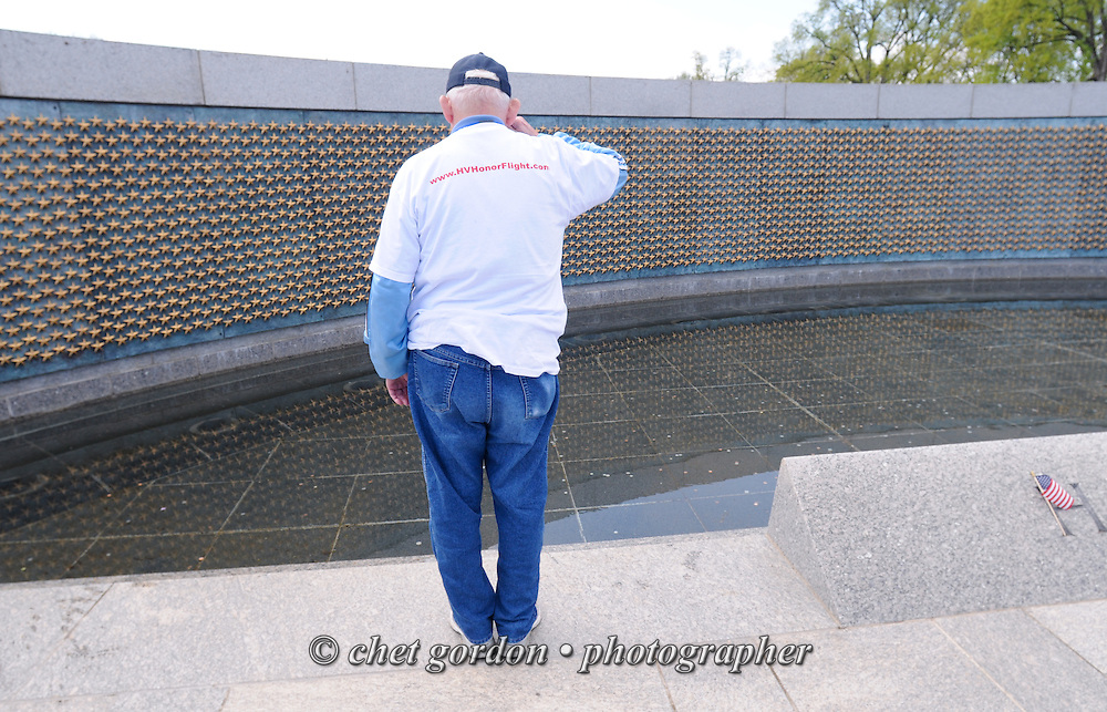 Alan Moskin (88) of Nanuet, NY salutes his fallen comrades at the Freedom Wall on the plaza of the WWII Memorial in Washington, DC on Saturday, April 26, 2014. Moskin was in Washington onboard the Hudson Valley Honor Flight. The national Honor Flight network with a local chapter based in Walden, NY offers free trips for WWII Veterans to view the WWII Memorial, Arlington National Cemetery and the Marine Corps War Memorial.  © www.chetgordon.com