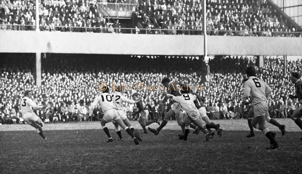 Irish Rugby Football Union, Ireland v England, Five Nations, Landsdowne Road, Dublin, Ireland, Saturday 8th February, 1969,.8.2.1969, 2.8.1969,..Referee- R P Burrell, Scottish Rugby Union, ..Score- Ireland 17 - 15 England, ..Irish Team, ..T J Kiernan,  Wearing number 15 Irish jersey, Captain of the Irish team, Full Back, Cork Constitution Rugby Football Club, Cork, Ireland,..A T A Duggan, Wearing number 14 Irish jersey, Right Wing, Landsdowne Rugby Football Club, Dublin, Ireland,..C M H Gibson, Wearing number 13 Irish jersey, Right Centre, N.I.F.C, Rugby Football Club, Belfast, Northern Ireland, ..F P K Bresnihan, Wearing number 12 Irish jersey, Left Centre, University College Dublin Rugby Football Club, Dublin, Ireland, ..J C M Moroney, Wearing number 11 Irish jersey, Left Wing, London Irish Rugby Football Club, Surrey, England, ..B J McGann, Wearing number 10 Irish jersey, Stand Off, Landsdowne Rugby Football Club, Dublin, Ireland, ..R M Young, Wearing number 9 Irish jersey, Scrum Half, Queens University Rugby Football Club, Belfast, Northern Ireland,..K G Goodall, Wearing number 8 Irish jersey, Forward, City of Derry Rugby Football Club, Derry, Northern Ireland,  ..J C Davidson, Wearing number 7 Irish jersey, Forward, Dungannon Rugby Football Club, Dungannon, Northern Ireland,  ..N Murphy, Wearing number 6 Irish jersey, Forward, Cork Constitution Rugby Football Club, Cork, Ireland,..M G Molloy, Wearing number 5 Irish jersey, Forward, London Irish Rugby Football Club, Surrey, England, ..W J McBride, Wearing number 4 Irish jersey, Forward, Ballymena Rugby Football Club, Antrim, Northern Ireland,..P O'Callaghan, Wearing number 3 Irish jersey, Forward, Dolphin Rugby Football Club, Cork, Ireland, ..K W Kennedy, Wearing number 2 Irish jersey, Forward, London Irish Rugby Football Club, Surrey, England, ..S Millar, Wearing number 1 Irish jersey, Forward, Ballymena Rugby Football Club, Antrim, Northern Ireland,..English Team, ..R B Hiller, Wearing number 15 English jersey