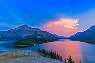 Sunset at Waterton Lakes National Park, Alberta, from the Prince of Wales Hotel viewpoint, July 15, 2014. This is a single frame from a time-lapse sequence. It is 1/40th sec at f/5.6 with the 16-35mm lens and Canon 6D at ISO 400.