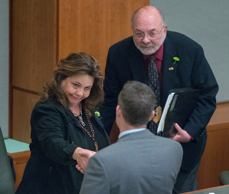 em031717a/a/Rep. Patricia Lundstrom, D-Gallup, shakes hands with House Minority Leader Nate Gentry, R-Albuquerque, after the House concurred with the Senate's changes to the State budget. at the Roundhouse in Santa Fe, Friday March 17, 2017. Bill Valdes, right, was there as an expert witness. (Eddie Moore/Albuquerque Journal