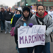 People march down University Avenue on their way to the state capitol during a #ReclaimMLK march organized by Black Lives Matter Minneapolis in conjunction with Ferguson Action's national day of action on the Rev. Martin Luther King, Jr. national holiday in St. Paul, Minnesota on January 19, 2015.  <br /> <br /> The event also was attended by the family of Marcus Golden, who was killed by St. Paul police officers last week. <br /> <br /> Photo by Angela Jimenez for MPR<br /> photographer contact 917-586-0916