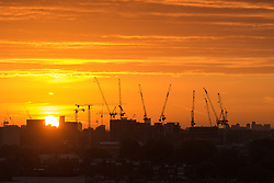 Primrose Hill, London, September 27th 2016. The sun rises over east London revealing the silhouettes of tower cranes, viewed from Primrose Hill as dawn breaks over the city. &copy;Paul Davey<br /> FOR LICENCING CONTACT: Paul Davey +44 (0) 7966 016 296 paul@pauldaveycreative.co.uk