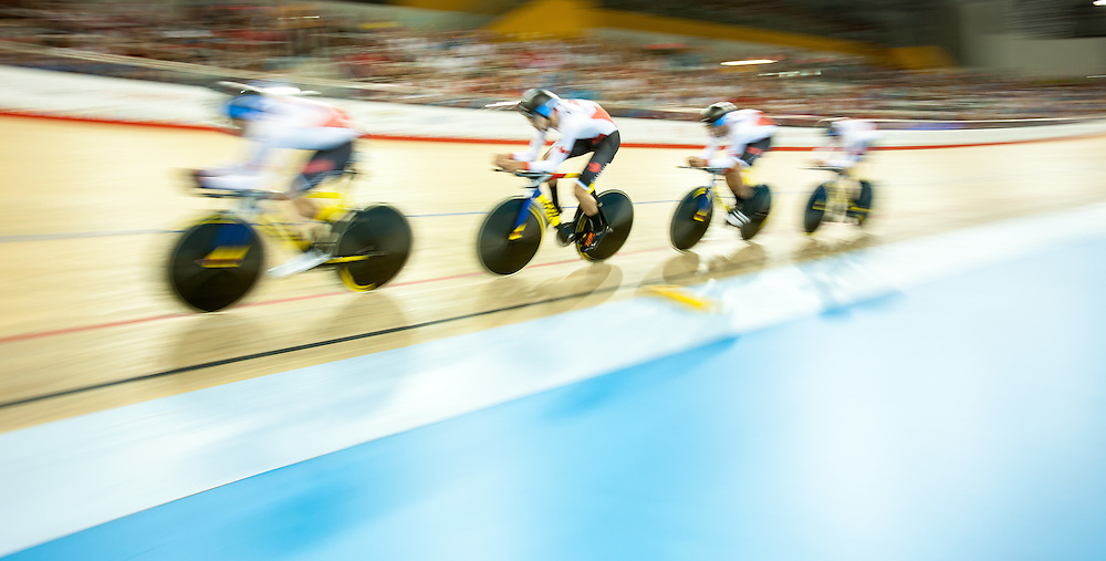 The Canadian team rides to a bronze medal win in the men's cycling team pursuit at the 2015 Pan American Games in Toronto, Canada, July 19,  2015.  AFP PHOTO/GEOFF ROBINS