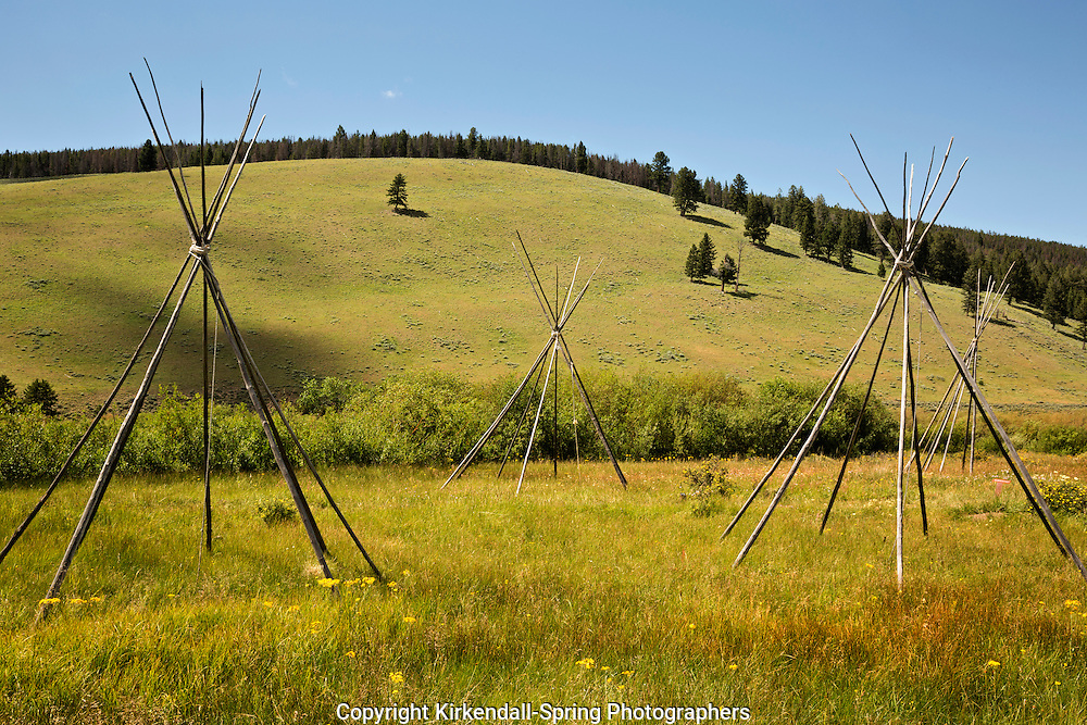 MT00080-00...MONTANA - Ghost teepees, poles standing to mark the location of where people were sleeping the night of the slaughter at the Big Hole National Battlefield.