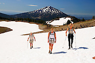 People hiking over snow field,Mount Bachelor in background,Cascade Range, Three Sisters Wilderness, Deschutes National Forest Central Oregon, Bend, Oregon, USA