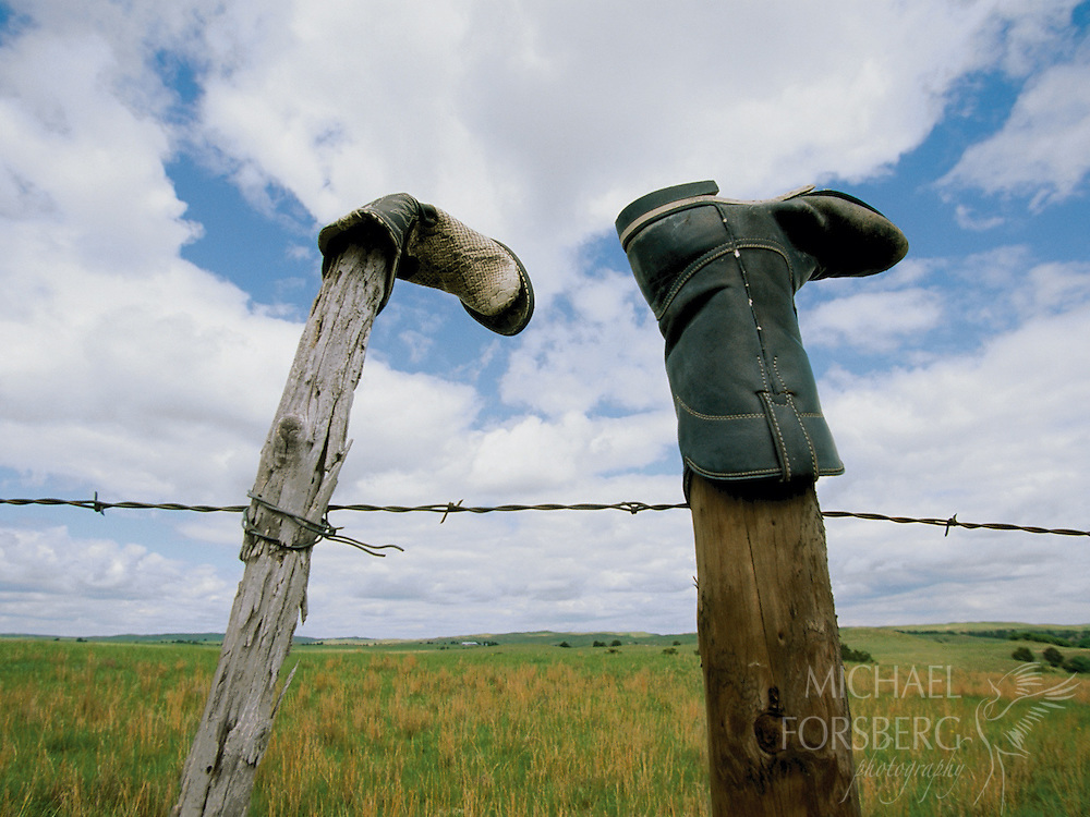 Cowboy boots and fence. Nebraska sandhills.