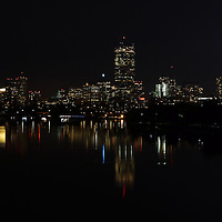 Boston skyline photography showing the Prudential Center with a Go Sox message, 111 Huntington Avenue office building, John Hancock Tower and Beacon Hill dark night reflection in the Charles River of the Boston Red Sox versus ST. Louis Cardinals World Series playoff game 6 on 30 October 2013 in Boston. <br />