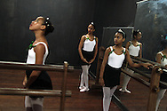 Girls perform during their ballet class at the 'Ballet Santa Teresa' academy in Rio de Janeiro August 13, 2012. 'Ballet Santa Teresa', a non-governmental organization (NGO) gives children who live in areas with social risk, some suffering domestic violence, free ballet classes and other activities as a part of socio-cultural integration project. Photo by: Pilar Olivares