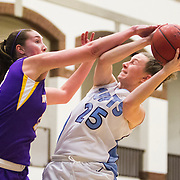 01/04/2013- Medford, Mass. - Tufts guard Liz Moynihan, A14, gets fouled by Williams forward Kellie Macdonald while going up for a jump shot in a 61-57 win over Williams at Cousens Gymnasium on Jan. 4, 2013. (Kelvin Ma/Tufts University)