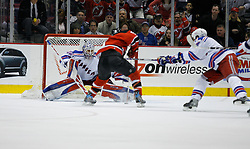 Feb 20, 2007; East Rutherford, NJ, USA; New York Rangers goalie Henrik Lundqvist (30) is scored on by New Jersey Devils forward Travis Zajac (9) during the third period at Continental Airlines Arena in East Rutherford, NJ.