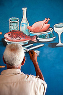 Sign painter in Belic, Granma, Cuba.