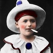Vintage Photo: Boy dressed as a Smoking clown, circa 1900.