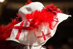 © Licensed to London News Pictures. 21/04/2017. LONDON, UK. A woman in and England hat watches morris dancers perform in Leadenhall Market in the City of London today, ahead of the official St George's Day this Sunday. Photo credit: Vickie Flores/LNP
