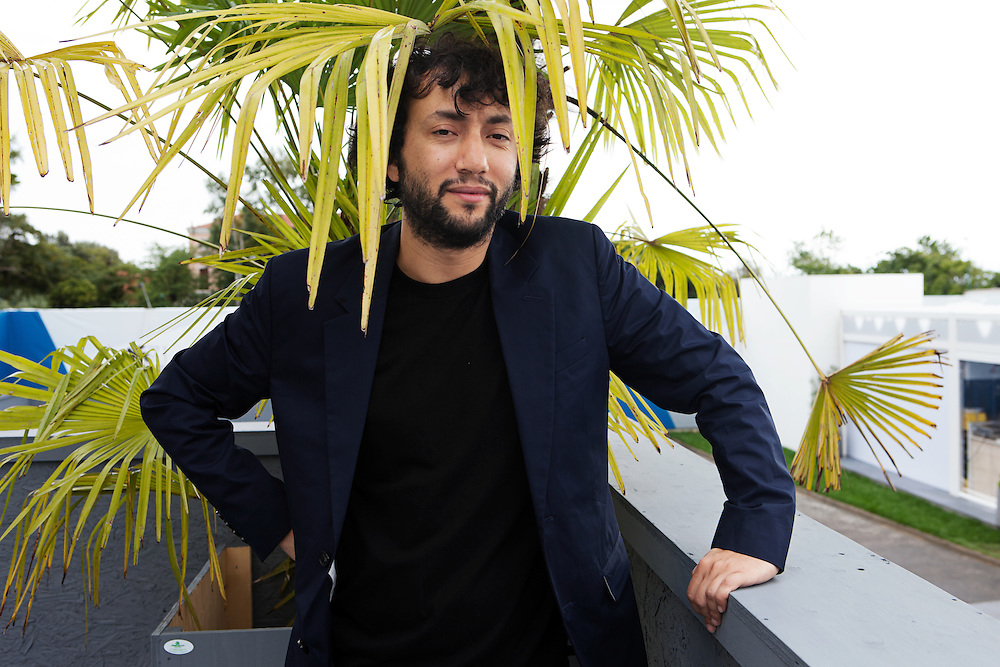 """Venice Lido, Italy, August 3, 2014. Kaan Mudjeci Turkish filmmaker living in Berlin, in Venice presenting his new work """"Sivas"""" at the 71st Edition of the Venice International Film Festival."""