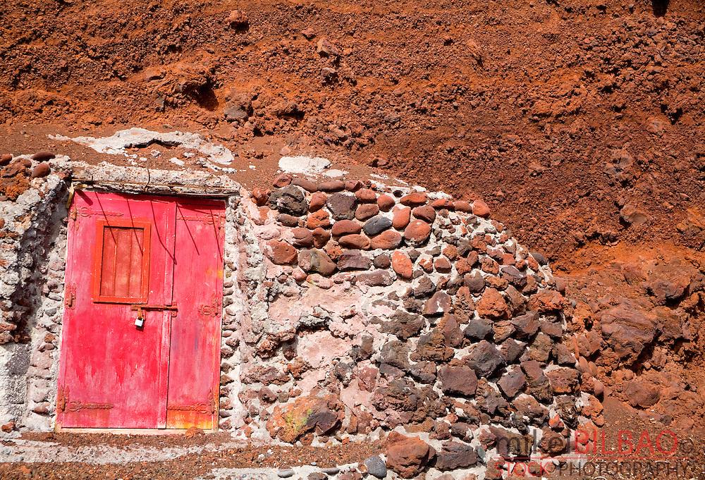 door in the red beach. Santorini island, Cyclades islands, Aegean Sea, Greece, Europe