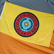 Seal of the Cherokee Nation Flag on side of tent at Thunderbird Pow-Wow, showing ethnic pride, heritage and celebration of Native Americans.  Often people camp out for this three day event.<br />