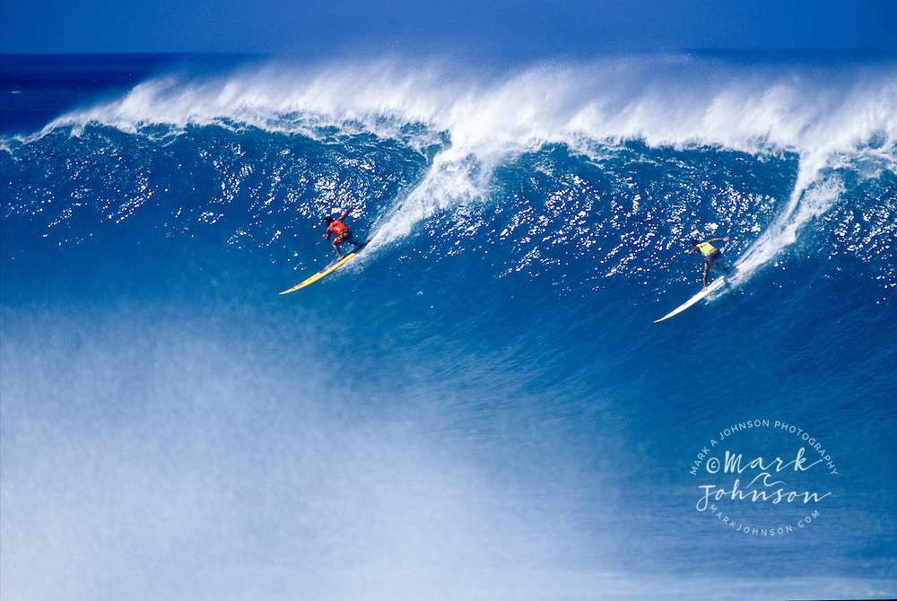 Surfers taking off  during the Eddie Aikau surfing tournament, Waimea Bay,  North Shore, Oahu, Hawaii