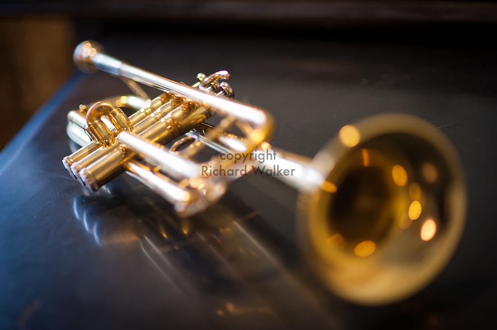 2015 August 15 - Trumpet on a piano, Seattle, WA, USA. By Richard Walker