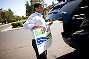 Republican congressional candidate Ricky Gill pulls a campaign sign out of his car for a supporter while canvassing in Stockton, Calif., September 18, 2012.