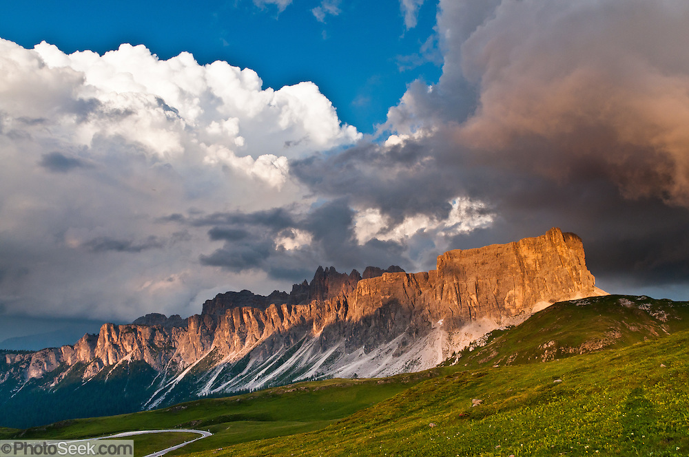 Orange sunset light spotlights Croda da Lago mountain, seen from Passo di Giau,  in the Dolomites (Dolomiti, a part of the Southern Limestone Alps), northern Italy, Europe. The Dolomites were declared a natural World Heritage Site (2009) by UNESCO.