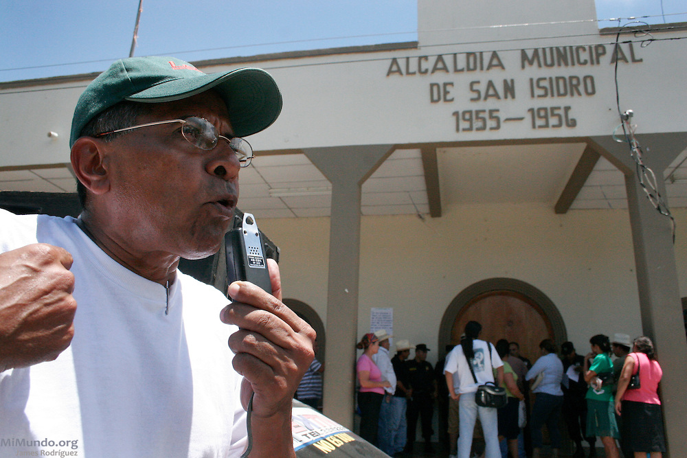 David Pereira, from the Research Center for Investment and Commerce (CEICOM), leads a protest against the El Dorado Mining Project in San Isidro, Cabañas. The El Dorado project's exploitation license, owned by Canadian Pacific Rim Mining Corp., was revoked in 2008 due to health and environmental concerns. Pacific Rim has since filed an international arbitration proceedings against the Government of El Salvador under CAFTA-DR free trade agreement claiming significant loss. San Isidro, Cabañas, El Salvador. June 12, 2007.