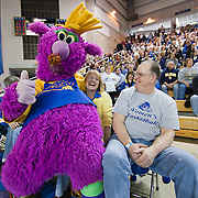 Reggy the Purple Party Dude sits on a fan lap during a halftime show of NCAA college basketball game against #9 Delaware and Northeastern Sunday, Feb. 26, 2012 at the Bob Carpenter Center in Newark, Del.