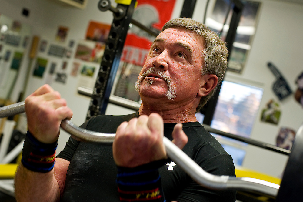 012811       Brian Leddy.Gary Schuster does curls while training for a lifting meet next weekend  in Mesa, Ariz.  Schuster was recently inducted into the National Athletes Strength Association Hall of Fame.