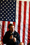 U.S. Democratic presidential candidate John Edwards speaks to potential voters during a campaign stop in Harlan, Iowa, October 16, 2007.