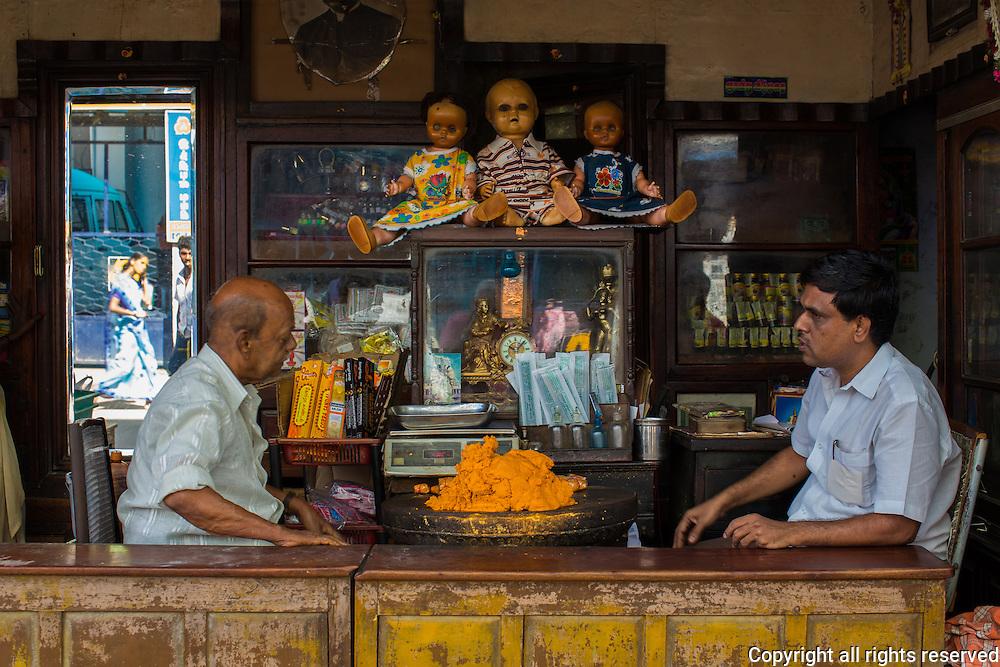 Dealers of sandalwood paste in their shop in Madurai, Tamil Nadu, India