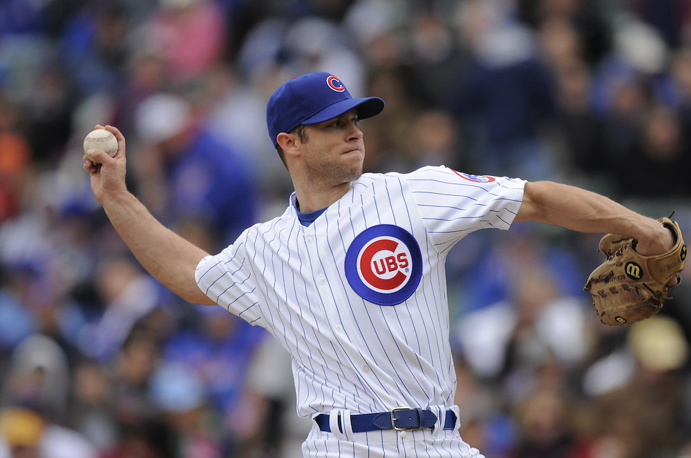 CHICAGO - APRIL 15:  Rich Harden #40 of the Chicago Cubs pitches against the Colorado Rockies on April 15, 2009 at Wrigley Field in Chicago, Illinois.  The Rockies defeated the Cubs 5-2.  (Photo by Ron Vesely)
