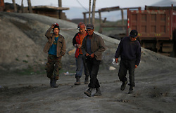 A picture made available on 05 July 2012 of Mongolian miners walking home from a coal mine in the mining town of Nalaikh in Mongolia, 02 July 2012. Once a thriving mining town, Nalaikh is one of first and oldest mining site in Mongolia but has seen a decline in its fortune as mining disasters and accidents plague the site. With little government oversight, only a handful of small companies and informal miners work on the site with scant regard to safety standards. Mongolia is rich in a variety of natural resources including forests, coal, iron ore, gold and copper. Expansion of the mining industry has turned the sector into the most important income source and led to an economic growth rate last year of around 17 per cent. The majority of raw materials are exported to China. Seeking to to reduce the dependency on China for exports and Russian imports, Mongolia has embarked on a policy of closer economic ties with other countries such as Germany, Canada and the United States. Despite impressive growth rates, about one-third of the population lives below the poverty line while unemployment and inflation are high.