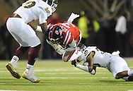 Mississippi running back Jeff Scott (3) is tackled by Mississippi State defensive lineman Denico Autry (90) and Mississippi State defensive back Jay Hughes (30) at Vaught Hemingway Stadium in Oxford, Miss. on Saturday, November 24, 2012. Mississippi won 41-24. (AP Photo/Oxford Eagle, Bruce Newman).