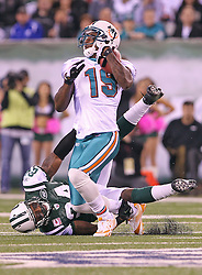 October 17, 2011; East Rutherford, NJ, USA; New York Jets cornerback Darrelle Revis (24) tackles Miami Dolphins wide receiver Brandon Marshall (19) during the first half at the New Meadowlands Stadium.