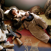 A Northern Alliance solider rests in a home in Maidan Shar after a skirmish with the Taliban while commanders hammered out the terms for the Taliban fighter's surrender.