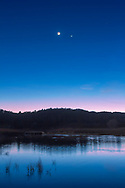 The waxing crescent Moon and Venus meet in conjunction over a pond on March 22, 2015. Earthshine is visible on the dark side of the Moon. Mars is below the Moon-Venus pairing. <br /> <br /> I shot this from the grounds of the Inn of the Mountain Gods, near Ruidoso, in the mountains of central New Mexico. This is an HDR high dynamic range stack of 3 exposures to preserve the bright twilight while bringing out the darker foreground. Shot with the Canon 60Da and 24mm lens.
