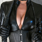 Leather, whip and a smile,<br /> <br /> Image concept of Dominatrix holding S&amp;M paraphernalia, s/m-leather-fetish
