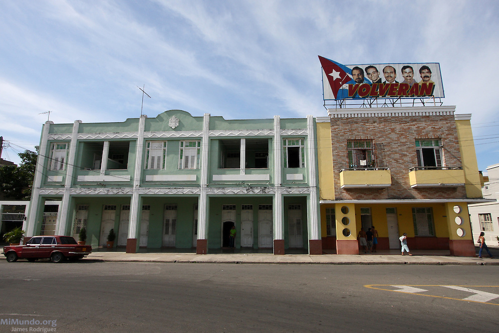 Neoclassical architecture in Cienfuegos, Cuba, with a billboard that supports the release of the so-called Cuban Five - Cuban intelligence officers arrested in the United States. January 2009.