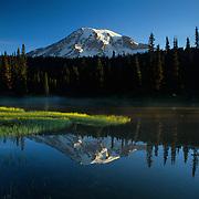 Mt. Rainier and mirror image in Reflection Lake, Mt. Rainier National Park, WA.