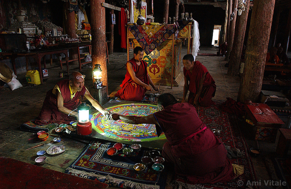 LEH, LADAKH, AUGUST 19: Ladakhi Buddhist monks .construct a mandala with sand and the dust of precious stones inside the Thiksay monastery, 17 kilometers outside of Leh, the capital of Ladakh, India August 19, 2003. . After the festival the mandala will be destroyed, thus expressing the impermanence of visible forms.  Nestled high in the Himalayas , the isolated area of Ladakh first opened to tourists in 1974, and is the home to one of the last surviving authentic Tibetan Buddhist cultures.  Leh is situated at a height of 3505 meters and once was part of the silk route of central Asia. Traders from exotic and far-flung lands have long spoken of the beauties of these lands. (Ami Vitale/Getty Images)