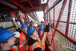 Bwani Junction, the Edinburgh based band, made music history by becoming the first group to play on the Forth Rail Bridge, they played on the highest point of the 122-year-old structure. On the way down in lift..©Michael Schofield.