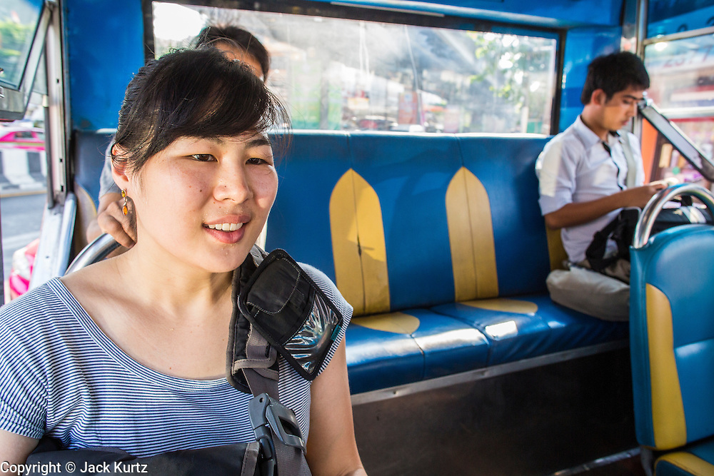 28 MARCH 2013 - BANGKOK, THAILAND: Michelle Kao rides a bus home after a day in the Thai Peace Foundation offices.      PHOTO BY JACK KURTZ