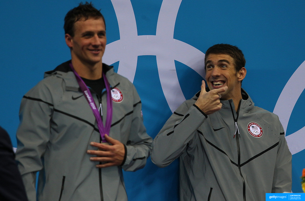 Michael Phelps, USA, winning the Gold Medal in the Men's 200m Individual Medley Final shares a joke about Ryan Lochte's mouth guard with someone in the stand during the medal presentation. Team mate Ryan Lochte who won silver at the Aquatic Centre at Olympic Park, Stratford during the London 2012 Olympic games. London, UK. 1st August 2012. Photo Tim Clayton