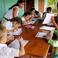 Central America, Costa Rica, Puerto Jiminez. Kids enjoy outdoor class at Esculea Carbonera, a small school nearby Lapa Rios.
