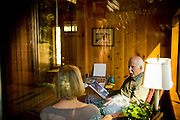 Sally, left, and Ron Grassi read in their Tahoe City, Calif. home May 13, 2010. Grassi is suing the big three ratings agencies after he lost $40,000 on a Lehman Brothers bond.