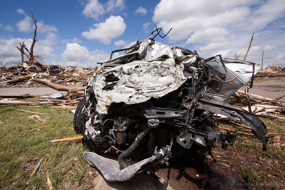 The remnant of a mangled car after being thrown a long distance by a tornado in Joplin, Missouri, May 25, 2011.  On May 22, 2011, Joplin Missouri was devastated by an EF-5 tornado.