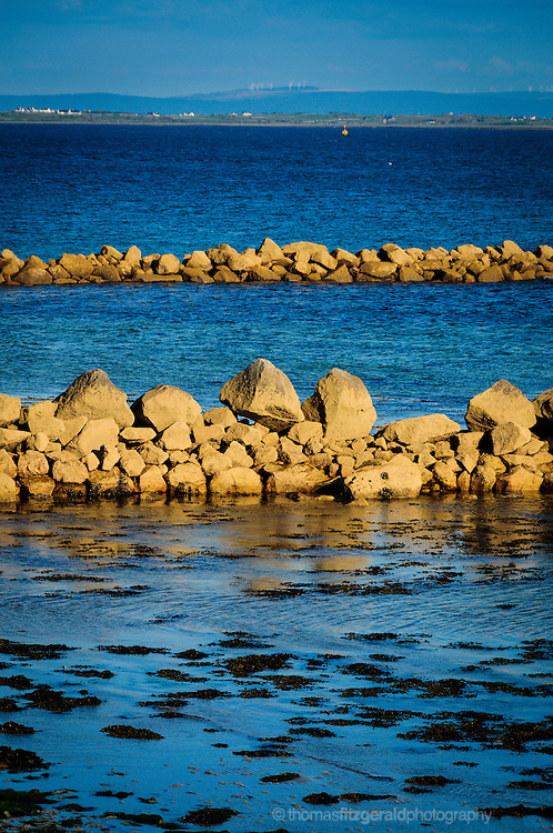 Galway, Ireland: Rocks form breakers on the beach at Salthill just outside Galway City