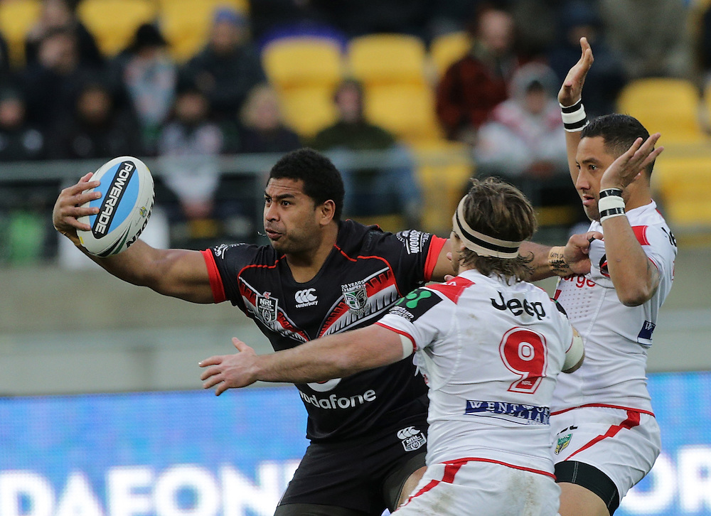 Sebastine Ikahihifo of the New Zealand Warriors is challenged by by Mitch Rein and Benji Marshall of the Dragons during their round 22 NRL match at Westpac  Stadium, Wellington on  Saturday, August 08, 2015. Credit: SNPA / David Rowland